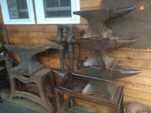 Antique blacksmith anvil, tongs, hammers, T-stake anvil, tools.