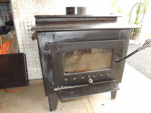 SOLD wood stove and selkirk chimney