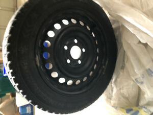 15 inch evergreen winter tires rims included
