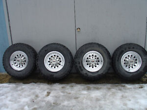2004 GMC/ CHEVY 8 STUD ION ALLOY RIMS+ TIRES.