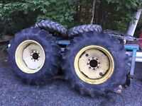 Two 13.6x24 tractor tires