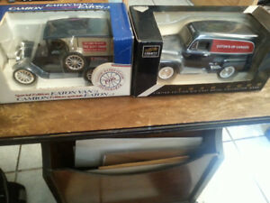 TWO EATONS DIECAST BANKS