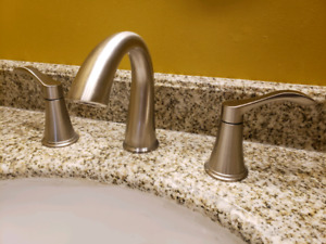 Two Sets Of Bathroom Faucets
