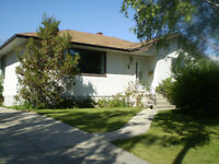 New S.W. inner-city bsmt suite, 2 bdrms, across from park