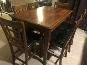 Pub height dining set with 8 chairs and leaf