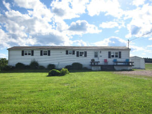 Well maintained mini-home on 1 acre of land