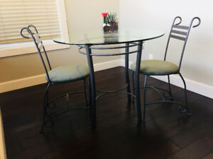 Glass top dining table with 2 chairs