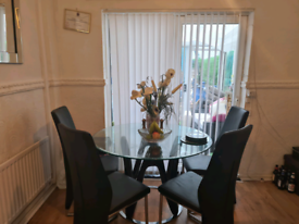Glass table and 4 chairs bought from barker and stone hous