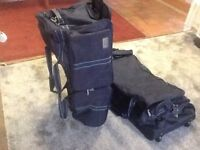 "2 blue holdalls/bags on 2 wheels Approx. 29"" long Lots of pockets Telford"