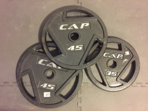 Olympic weight plates 45lbs x 2, 35lb x 1 with easy grip handles