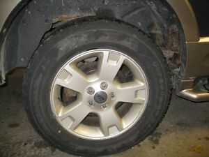 Ford Explorer aluminum rims and tires London Ontario image 1
