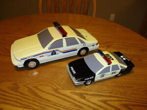 2 Police Cars  These are lightly used and in good condition