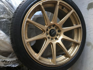 M+S Four tires with sports Alloy Rims