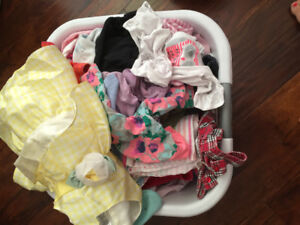 Basket of baby girl clothes