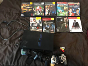 Playstation 2, 2 controllers, and games