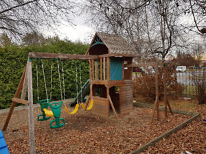 Kids wooden swing set with playhouse