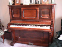 lovely upright piano with bench