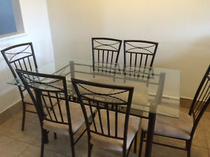 Glass dinning table set with 6 chairs