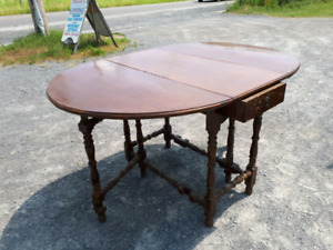 DINING TABLES & A 2 DRAWER STAND & ROCKER & 2 CHAIRS