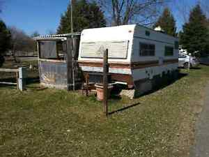 Trailer with covered deck