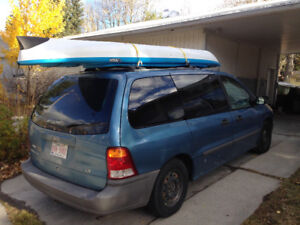 2001 Ford windstar mini van with fold out bed.