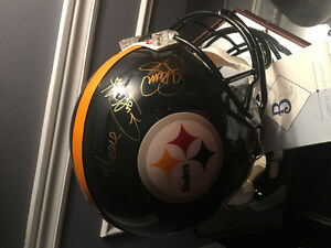 Authentic Autographed Helmet by The Steel Curtain