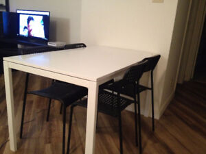 MELLTORP dinning set, table and 4 chairs, small dent, obo