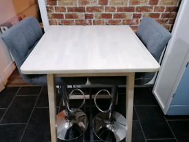 Bar table including bar chairs