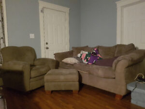 Olive green couch and chair with ottoman