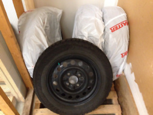 Set of Studded Goodyear Nordic winter tires on rims - 185/65R15