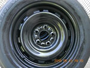 FOUR- 4 SEASON TIRES 215-60R-16 ON RIMS  GOOD THREAD