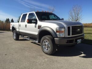 2008 Ford Diesel 4x4 Lariat Crew Cab saftied. Black Lthr sunroof