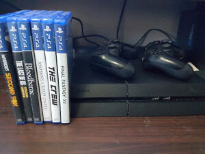 PS4 with 2 controllers and 6 games