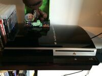 PS3 with controllers and games and movies