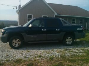 2002 Chevrolet Avalanche that is in good shape