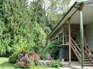 Beautiful 5 Acres by the Goat River in Creston