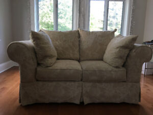 Plush, well-maintained, off-white fabric, 72' couch.