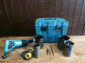 Makita diamond drill core cutter kit 110v. Comes with case and 4 core