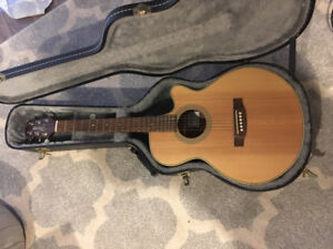 Beautiful 3/4 size Takamine series G guitar with hard case.