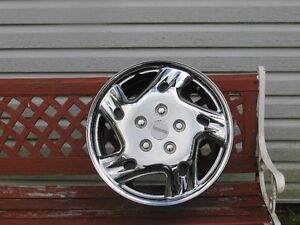 """Four 16"""" Steel Rims with hub caps"""
