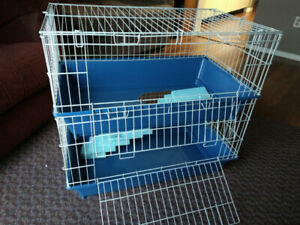 Small pet cage with rat accessories