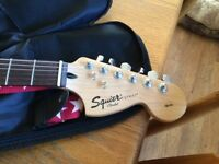 Fender squire blue electric guitar with fender amp