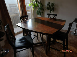 Bar height dinning table includes 4 X-back chairs