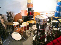 many drums and cymbals for sale