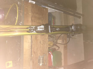 2 sets of skis and boots- ladies