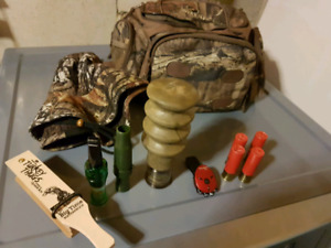 Hunting calls, pouch, camo hat etc.