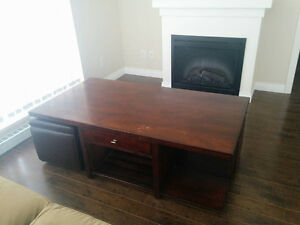 Brown coffee table with 2 Ottomans - $100