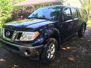 2011 Nissan Frontier SV Pickup Truck with cap and tonneau.