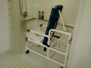 Bath and Toileting.  Tilt-N-Space Shower Commode Chair