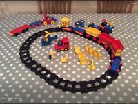 Vintage Duplo train track with various accessories